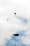 One Kite Flying over a Cloudy Sky Royalty Free Stock Photos