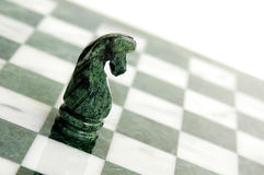 One knight. Chess knight piece alone  on the board Royalty Free Stock Image