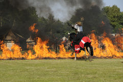Knight on horse. One of the knight from ars equitandi riding through fire. Ars Equitandi are show riders that often occurring on medieval festivals in Germany stock images