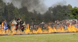 Knights on horse. One of the knight from ars equitandi riding through fire. Ars Equitandi are show riders that often occurring on medieval festivals in Germany stock image