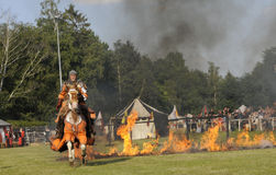 Knight on horse. One of the knight from ars equitandi riding through fire. Ars Equitandi are show riders that often occurring on medieval festivals in Germany royalty free stock photos