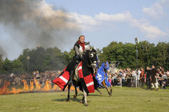Knight on horse. One of the knight from ars equitandi riding through fire. Ars Equitandi are show riders that often occurring on medieval festivals in Germany stock image