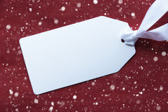 One Label On Red Background, Snowflakes And Copy Space royalty free stock photo