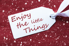 One Label On Red Background, Snowflakes, Quote Enjoy Little Things Royalty Free Stock Photo