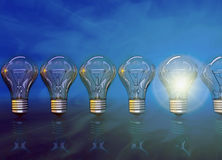 One lamp shines, 3D. Line  from seven lamps, one lamp shines Stock Photo