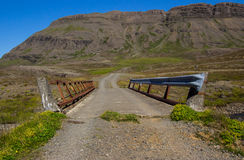 One Lane Bridge. A narrow old bridge allows passage of only one vehicle at time on a gravel road in the mountains of Iceland Stock Photography