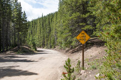 One Lane Road Sign in the Mountains Royalty Free Stock Photography