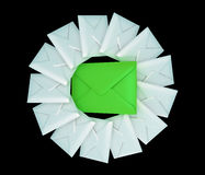 One large and many small envelopes over black Stock Photos