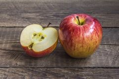 One large and one chopped apple Royalty Free Stock Images