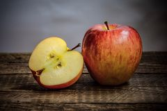 One large and one chopped apple Stock Images