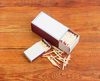 One large and one small matchboxes of wooden safety matches Royalty Free Stock Photos