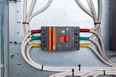 One large power circuit breaker in the electrical Cabinet. stock images