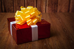One large red gift box on a wood Stock Photos
