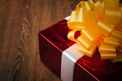 One large red gift box on a wood Royalty Free Stock Image