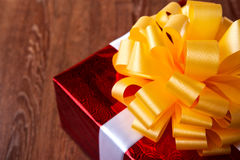 One large red gift box on a wood Stock Photo