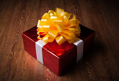 One large red gift box on a wood Royalty Free Stock Photo