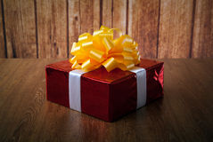 One large red gift box on a wood Stock Image