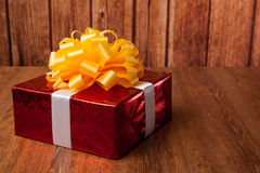 One large red gift box on a wood Royalty Free Stock Photography