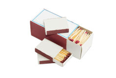 One large and several small matchboxes of wooden safety matches Royalty Free Stock Images