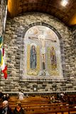 GALWAY, IRELAND - FEBRUARY 18, 2017: People praying inside of the Roman Catholic Cathedral of Our Lady Assumed into Heaven and St stock photo