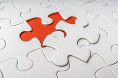 One last piece of white empty puzzle is missing Stock Image