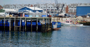 One of last working waterfronts on Atlantic Coast. Piers in Portland, Maine, extending into Casco Bay, and showing Portland`s working waterfront, construction Royalty Free Stock Image