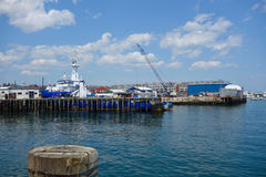 One of last working waterfronts on Atlantic Coast. Portland, Maine, piers, extending into Casco Bay, and showing Portland`s working waterfront, docked boats Royalty Free Stock Image