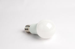 One LED energy saving light bulbs over the old incandescent, use of economical and environmentally friendly light bulb Stock Photos