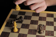 One Left Male Hand Playing Chess Stock Photo