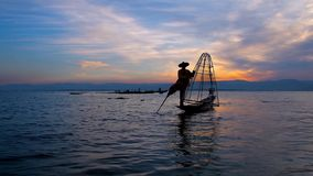 Sunset trip on Inle Lake, Myanmar. The one leg paddling is the visit card of fishermen on Inle Lake, they often entertain tourists, who makes the trip to enjoy stock footage
