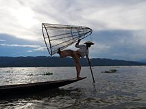 One Leg Rowing Fisherman on Inle Lake royalty free stock photo