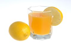 One lemon with glass with a slice of lemon filled with citrus ju Royalty Free Stock Photography