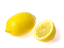 One lemon and half Royalty Free Stock Image