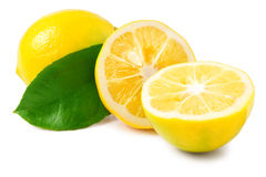 One lemon with leaves and slices on white background Stock Image