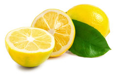 One lemon with leaves and slices on white background Stock Photo