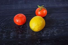 One lemone and two tangerine Royalty Free Stock Photos