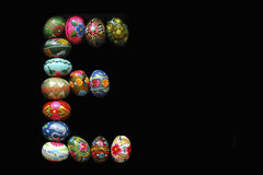 One of the letters of the word `Easter`. Letters are made of Easter eggs, of different colors and with different patterns. Royalty Free Stock Photo