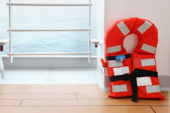 One life jacket stands on deck of cruise liner Royalty Free Stock Photo