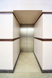 One lift with closed metallic doors stock images
