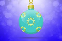 One light blue hanging christmas tree ball with golden stars ornaments on a blue background with lens flare. One single light blue hanging christmas tree ball Stock Photos