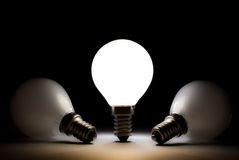 One Light Bulb Shining Other Bulbs Dead Stock Image