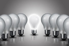 One Light bulb turn on in the center Royalty Free Stock Image