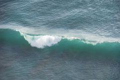 Breaking turquoise wave in Bali, Asia Royalty Free Stock Images
