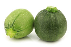 One light green and a green round zucchini Royalty Free Stock Photography