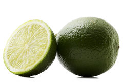 One lime and a half. Lime on white background stock image
