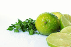 One lime and pices. And a little parsley on white background Stock Photo