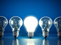 One lit bulb among unlit ones Stock Photography
