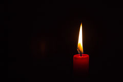 One lit candle Royalty Free Stock Image