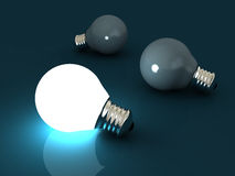 One lit light bulb amongst other dark light bulbs Stock Photography