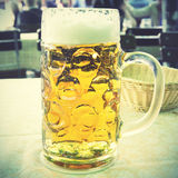 One liter beer mug. On a table. Retro style filtered image Royalty Free Stock Image